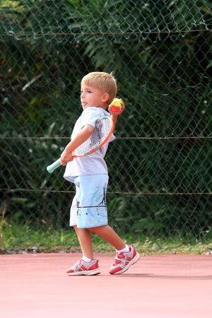 boy throwing a tennis ball Stock Photo - 541791