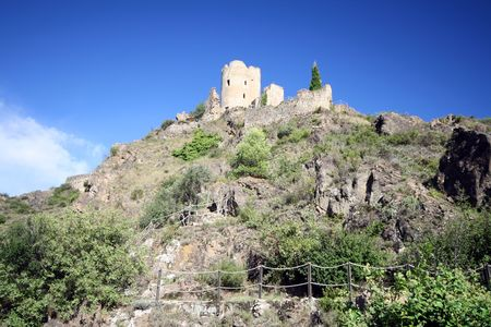 fortified castle ruins on a crest photo