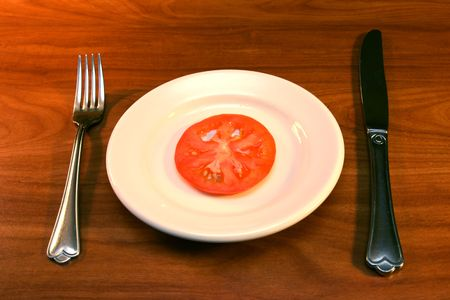 tomato slice with fork and knife Stock Photo - 563326