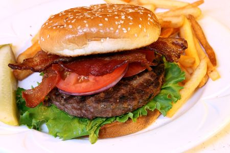 hamburger with bacon and pickle on the side Stock Photo - 563213