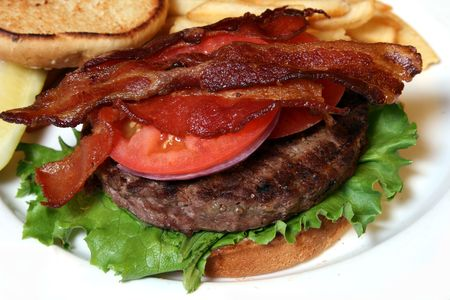 slices of bacon on a beef hamburger