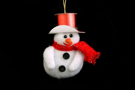 christmas snowman on a black background photo