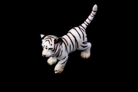 white tiger plastic toy photo