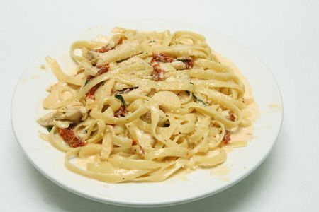 tagliatelle carbonara with sundried tomatoes Stock Photo