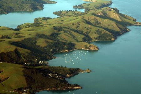 Sailboats in a bay in new zealand Stock Photo