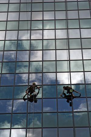cleaning team: Equipo de limpieza de vidrio sobre antecedentes couds