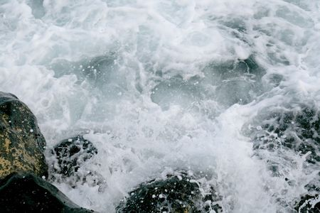 swell: sea swell on shore rocks