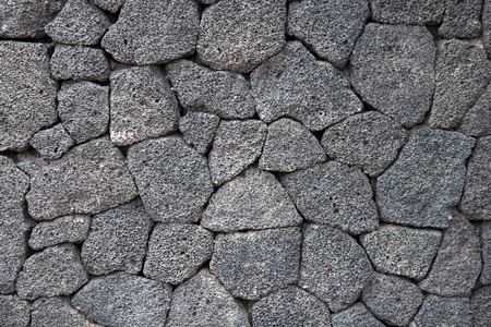 volcanic stones: grey tiles volcanic stone texture and background Stock Photo