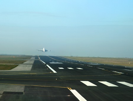 Airplane taking off the runway photo