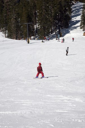beginner: beginner kid on skis on slopes