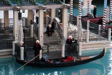 gondoliers: Venetian gondola with three gondoliers Stock Photo