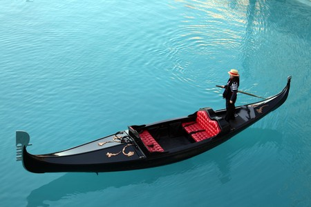 Venetian gondola on blue turquoise waters