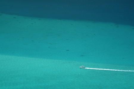 motor boat cruising on a turquoise lagoon photo