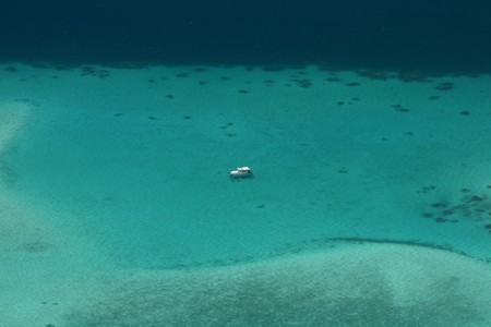 yacht at anchor on the turquoise lagoon photo