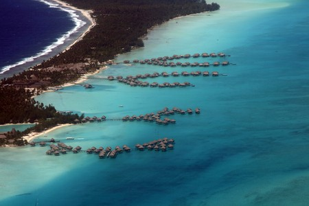 overwater hotel bungalows in south pacific island photo