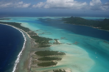 pacif island with a coral reef resort photo