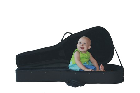 baby in a spanish guitar case Stock Photo