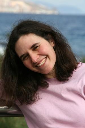 brune: woman on the ocean shore, smiling