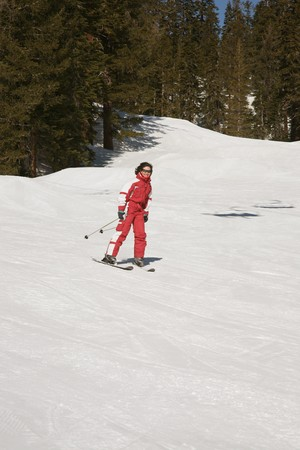 brune: woman descending ski slopes in a resort