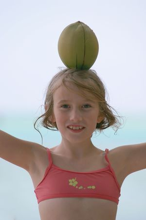 coconut on pink bikini girl head Stock Photo