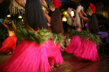 group of exotic dancers in red skirt