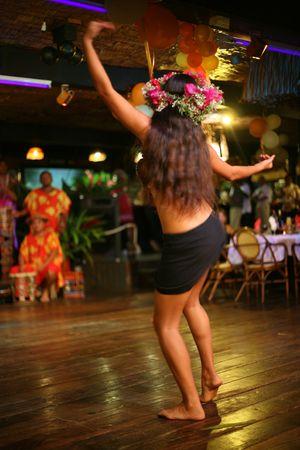 tahitian: woman performing traditional tahitian dance