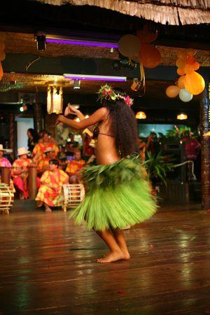 tahitian: tahitian woman dancing traditional style Stock Photo