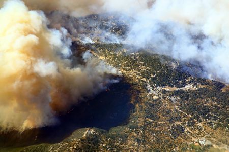 aerial views: mountain village on fire in California