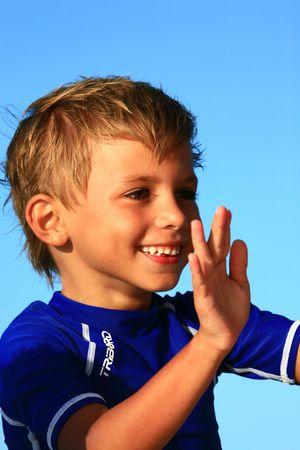 boy playing with hands Standard-Bild