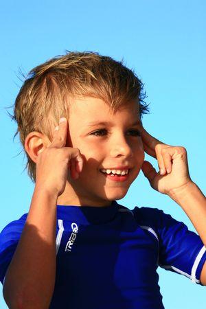 holding the head: Boy holding head