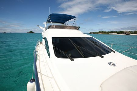starboard: motor yacht on a turquoise water beach Stock Photo