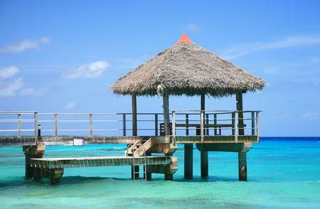 wood pontoon on a paradise island lagoon photo