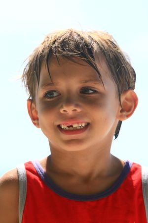 boy smiling at the beach photo