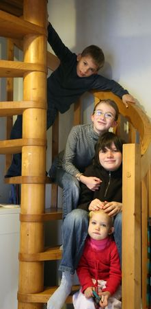groups of four kids in wood staircase photo