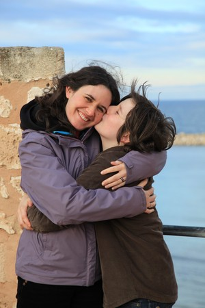 son kissing mother in an tourist old stone castle Stock Photo