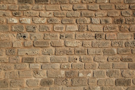battlements: defense stone wall texture and background Stock Photo