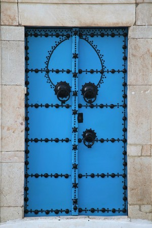 wood and stone door in arabic style