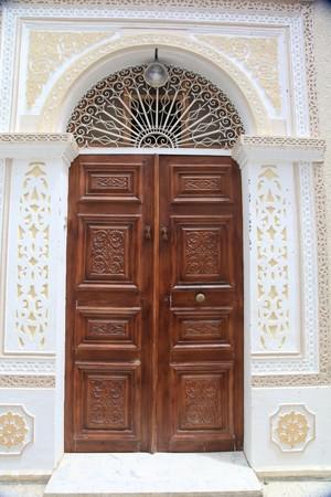 old decorated door in tunisia city photo