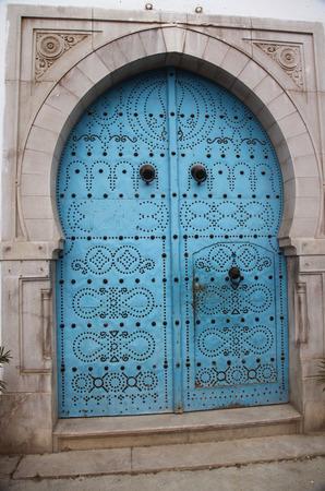 arabic blue door with decorative nails