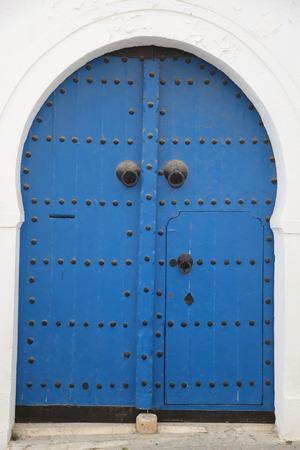 blue arabic door wih decoratve nails