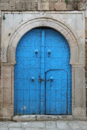 old arabic wooden door in tunisian city