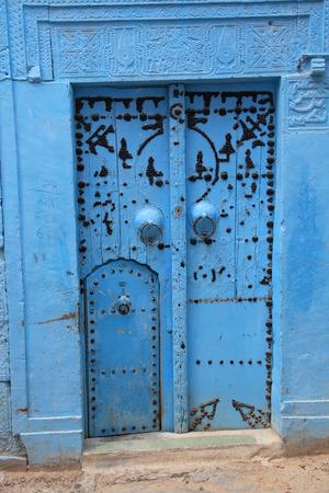 ancient blue door in tunisian art style