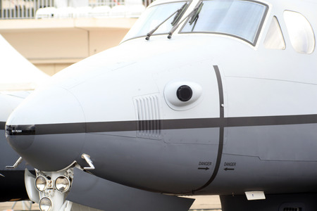 nose of a surveillance plane with thermal camera Stock Photo