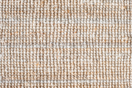 Jute fabric or thick jute carpet for background. Natural sackcloth texture. Copy space for text.