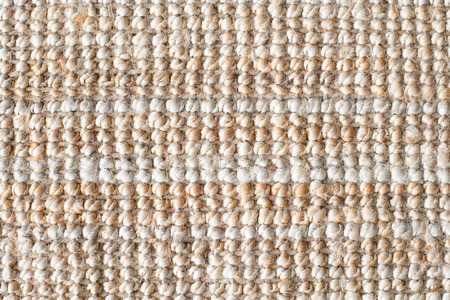 Jute fabric or thick jute carpet for background. Close up of natural sackcloth texture. Copy space for text.