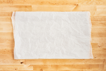 Crumpled piece of white parchment or baking paper on wooden table. Top view. Copy space for text and design element. Stock fotó