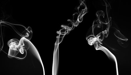 Isolated white smoke on black background. Design element. Natural smoke.