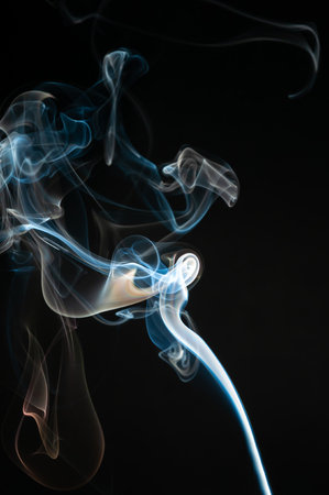 Isolated white and blue smoke on black background. Design element. Natural smoke. Banco de Imagens