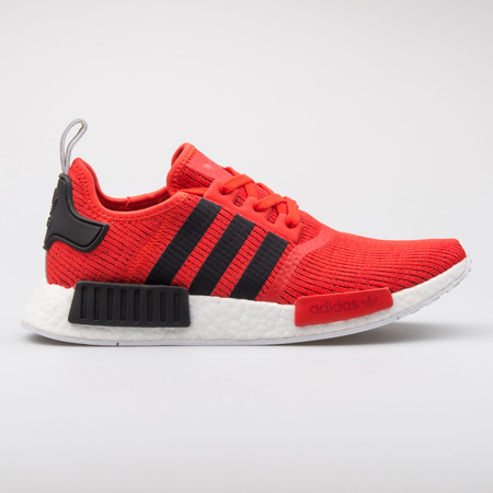 VIENNA, AUSTRIA - AUGUST 7, 2017: Adidas NMD R1 red and black sneaker on white background. Editorial