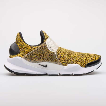 VIENNA, AUSTRIA - AUGUST 7, 2017: Nike Sock Dart QS yellow and black sneaker on white background. Editoriali